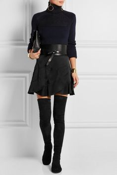 A clingy black turtleneck is as sleek and sexy as can be — Play it up by adding a black miniskirt, thigh-high boots, and a wide waist cincher. Wicked.