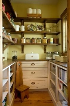 Perfect pantry with shelves above, cabinets below, a counter and a window. Love the antique stepping stool.
