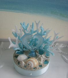 Hi:) Two blue glass Dolphins come together for a wedding day smooch! Coral accents~~~a touch of sand~~Blue Sea Glass and exotic seashells add to the fun in this one-of-a-kind design! Beach Wedding Cake Toppers, Wedding Cakes, Seashell Wedding, Coral Accents, Dolphins, Sea Shells, Snow Globes, Exotic, Wedding Decorations