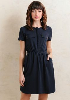 Casual and chic, this navy-hued mini dress features a fit-and-flare silhouette with a comfortable elastic waistband and short sleeves. Complete with a hidden four-button closure down the front, t...