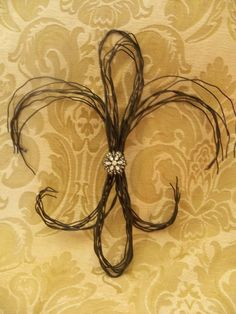 Fleur di lis. Maybe incorporate trigs or branches?