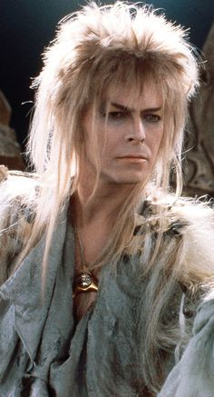 1986 - David Bowie as Jareth, The Goblin King in Labyrinth. I'll paint you mornings of gold. I'll spin you Valentine evenings. Though we're strangers 'til now, We're choosing the path Between the stars. I'll leave my love Between the stars. David Bowie Labyrinth, Labyrinth Movie, Labyrinth 1986, Goblin King Labyrinth, Jareth Labyrinth, William Shakespeare, Last Unicorn, King David, David Bowie Goblin King