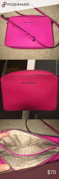 Michael Kors Saffiano Leather Crossbody Excellent condition (inside and out) magenta Michael Kors cross body. Silver accents. Three inside slip pockets. Adjustable silver chain strap. Top zip closure. Saffiano leather-- easy to clean! Michael Kors Bags Crossbody Bags
