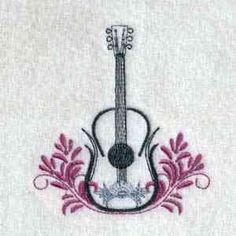 This free embroidery design is a guitar.  Don't miss it!