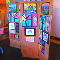 I built this four panel display panel for my art camp. I used it for our ending art show. I glued cork on the panels and pinned each piece up.