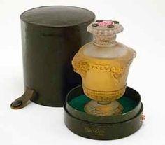 R. Lalique Guerlain Bouquet de Faunes perfume bottle and stopper, frost glass, grey patina, sealed, metal grommets, label, box.