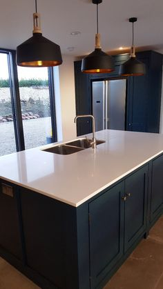 A stunning example of one of our handmade kitchens, this one painted in a Mid Grey, with White quartz and also Copper worktops. Featuring an undermounted sink Kitchen Paint, New Kitchen, Smart Kitchen, Kitchen Cabinets, Blue Shaker Kitchen, American Style Fridge Freezer, Classic Kitchen, Minimalist House Design, Handmade Kitchens