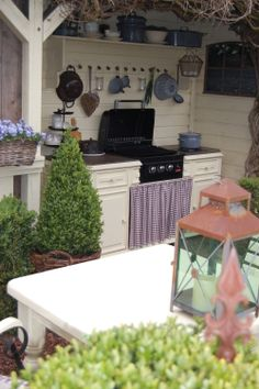 What a clever and beautiful outdoor idea! Looks so much like a kitchen in an old farm house. Outdoor Living Areas, Outdoor Spaces, Porches, Outdoor Kitchen Grill, Outside Seating Area, Porch Plans, Backyard Plan, Shabby Home, Small Greenhouse