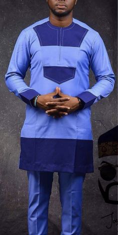 Call, SMS or WhatsApp if you want this style, needs a skilled tailor to hire or you want to expand more on your fashion business. African Male Suits, African Wear Styles For Men, African Shirts For Men, African Dresses Men, African Attire For Men, African Clothing For Men, Latest African Fashion Dresses, African Men Fashion, African Traditional Wear
