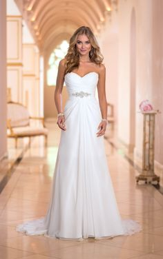 Royal elegance meets modern day fairy tale in this enchanting white strapless chiffon wedding dress! Strapless A line gown features stunning pleated sweetheart neckline and beaded belted waist. Floor length skirt with sweep train, lace-up back.