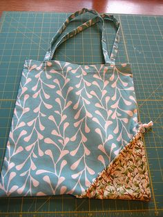 Tote bag in a pocket!! I'm thinking how many of these I could fit in my diaper bag and never forget my grocery bags again!