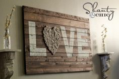 A rustic love sign with burlap rosettes - perfect for a barn wedding