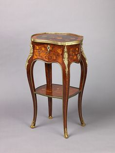 We often call upon the rich curves and design lines of Louis XV furniture in creating many of our new designs. Pictured: Louis XV marquetry and bronze dore table de salon.