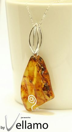 Sterling silver necklace with raw polished natural Baltic amber by byVellamo, $45.00