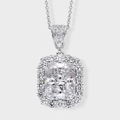 3.5 Ct. Radiant Cuti  14K Fancy Pendant. Fancy cubic zirconia pendant features 3.5 carat radiant cut surrounded by prong set round stones. An approximate 4.34 total carat weight, set in 14k white gold. An Italian cable chain is included, with your choice of 16 inch or 18 inch length. The pendant measures about 1 inch long (including the bail) and 0.50 inch wide. This high quality cubic zirconia pendant is also available in 14k yellow gold via special order.