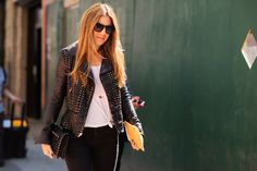 Studded Leather Jacket paired with a studded leather clutch! New York Street Style - Fashion Week 2014