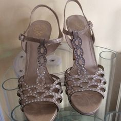 Brand new Vince Camuto heels Never worn!!  Gorgeous Vince Camuto gold and rhinestone leather heels.  Muted gold color with just enough shimmer to look gorgeous in the lights. Small platform for added comfort Vince Camuto Shoes Heels