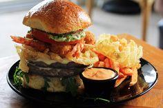 steak & fried shrimp double cheeseburger w/ onion straws & arugula-pesto mayo