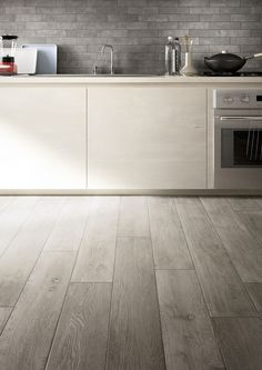 44 ideas kitchen grey floor tiles dark for 2019 Grey Flooring, Wood Tile Floor Kitchen, Best Flooring For Kitchen, Flooring, Grey Kitchen Floor, Grey Kitchen Tiles, Grey Wood Tile, Laminate Flooring In Kitchen, Ceramic Wood Tile Floor