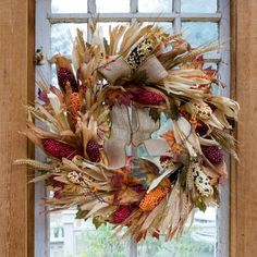 """Corn Husk Autumn Heritage Wreath-Corn Husks, Wheat, Burlap Ribbon and Faux Indian Corn make this a fall farmhouse showstopper. Hand crafted and ready to grace your homestead!26"""" DiameterThis is a handcrafted seasonal item. Please allow up to 6 weeks for delivery."""