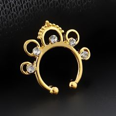 Yellow gold plated fake septum ring with crystals New. Stunning yellow gold plated fake septum ring with crystals. Thank you for visiting my closet, please let me know if you have any questions. I offer great discounts on bundles  also available in rose gold and silver - there're separate listings for those. Boutique Jewelry