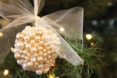 do it yourself divas: DIY: Pearl Ornament with tulle bow would be a pretty idea for newlyweds :D