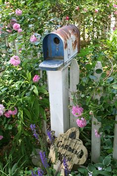 An old mailbox turned into a birdhouse