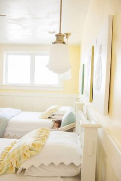 Modern Country Shared Girls Room - love the hanging light fixtures over the bed!