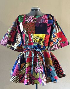 African Wax Print Patchwork Drawstring Tunic With Half Sleeves Pullover 100% Cotton.  Ankara | Dutch wax | Kente | Kitenge | Dashiki | African print bomber jacket | African fashion | Ankara bomber jacket | African prints | Nigerian style | Ghanaian fashion | Senegal fashion | Kenya fashion | Nigerian fashion | Ankara crop top (affiliate)