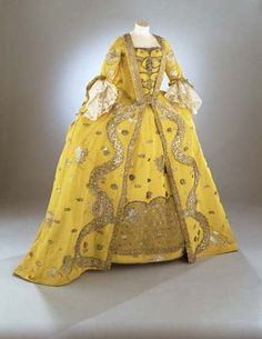 "Yellow as a very fashionable color in 18th c. London. This was one of the gowns that inspired the cover art on ""A Sinful Deception."" Overdress of a woman's 3 piece dress (robe à la française) English Silk extended tabby (gros de Tours) with liseré self-patterning and brocading in silver lamella and filé circa 1750s Rococo Area of Origin: England (London, Spitalfields)"
