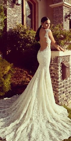 Backless lace mermaid wedding gown with straps. Maybe not this low in the back but love the lace and idea of this gown