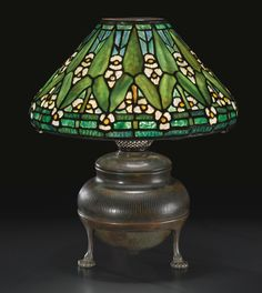 """Tiffany Studios a rare """"Arrowhead"""" Table Lamp  c. 1905  shade and base impressed, leaded glass and patinated bronze  16-1/2 inches high   Sotheby's n09155lot7dbqdfr"""