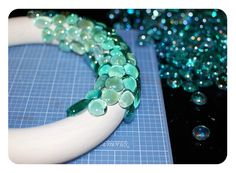 Glue glass gems to foam wreath.  Beautiful!