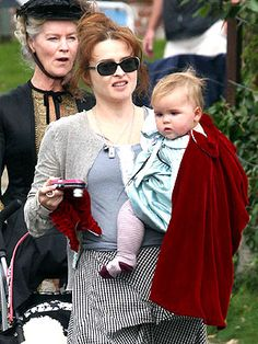Nell's wearing a cape...Because her mother is amazing.
