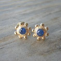 Golden balls of sunshine, these are! 3.5mm rich blue sapphires grace the 14k yellow gold setting I hand carved. $298