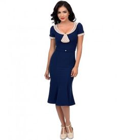 This classic and understated frock will send you back in time! A distinct wiggle dress in a deep navy with beige contras...Price - $150.00-pnNbZSG8