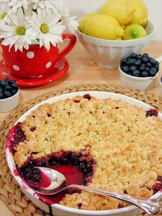Best Ever Blueberry Cobbler  I would add 3 more cups of blue berries.  Baked it in  9 x 13 pan.