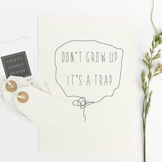 Hang this beautiful 'Don't grow up it's a trap' inspirational print on your walls ◦ Materials: Archival Paper, Ink, Love ◦ Made to order ◦ Frame is not included in the purchase ◦ Handmade in USA ◦ Arr