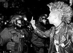 A Punk Flipping Off A Cop...