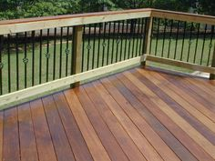 decorative aluminum black rail | Ipe deck in Fortsyth GA with wooden rail and metal pickets with basket ...