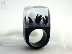 Zombie – creepy undead ring with three black hands and fog on a black ring made of resin. Made by GeschmeideUnterTeck
