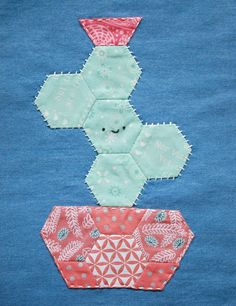 This Happy Cactus Applique Pattern makes the perfect cuddly companion for your next quilt, tote, place mat, or mini quilt.