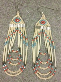 Beaded Coral/Turquoise/Bone Quill Earrings by prettyuniquedesigns2. $19.00, via Etsy.