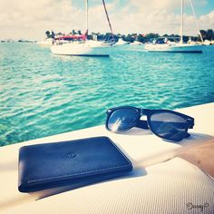 It's only Tuesday? No one says you can't go sailing today! Slim Leather Wallet, Slim Wallet, Ocean Sailing, Italian Leather, Tuesday, Sunglasses Case, Black Leather, Weather, Blue
