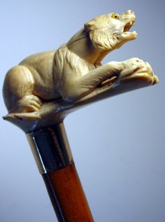 A rare, turn-of-the-century carved-ivory figure of bear. Bear, rabbit and pig handles are scarce. T