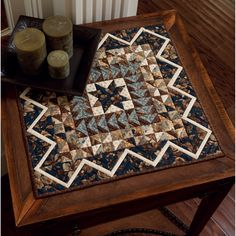 Use the timeless color combination of blue, cream, and brown to create this elegant little quilt by Jo Morton.
