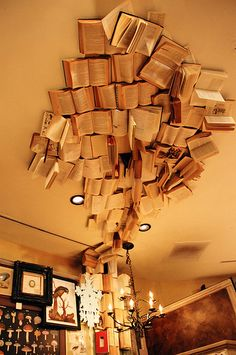 This would be so awesome...even though I wouldn't be able to bear the process of nailing, gluing, -what have you- books to the ceiling.