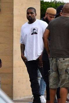 2d6672879 Kanye West spotted in Malibu wearing white tee by Boot Boyz Biz Kanye West  Style