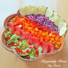 """Salads are not only quick to prepare, but they are super versatile which means a lunch or dinner will never get boring! Try this Delicious Rainbow Salad made of Chopped Romaine, Shredded Purple Cabbage, Cucumber, Red Bell Pepper, Diced Papaya and Grapefruit Segments with a Tomato, Cucumber, Fresh Squeezed Grapefruit Juice and Fresh Basil Leaves """"Gazpacho"""" Dressing.How you eat is how you live."""