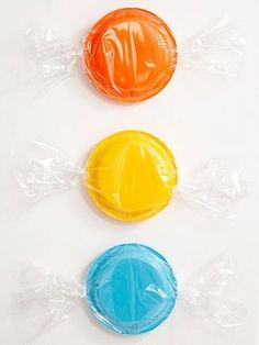 Wrap colorful paper plates in cellophane to make them look like big pieces of candy - for wall decor.